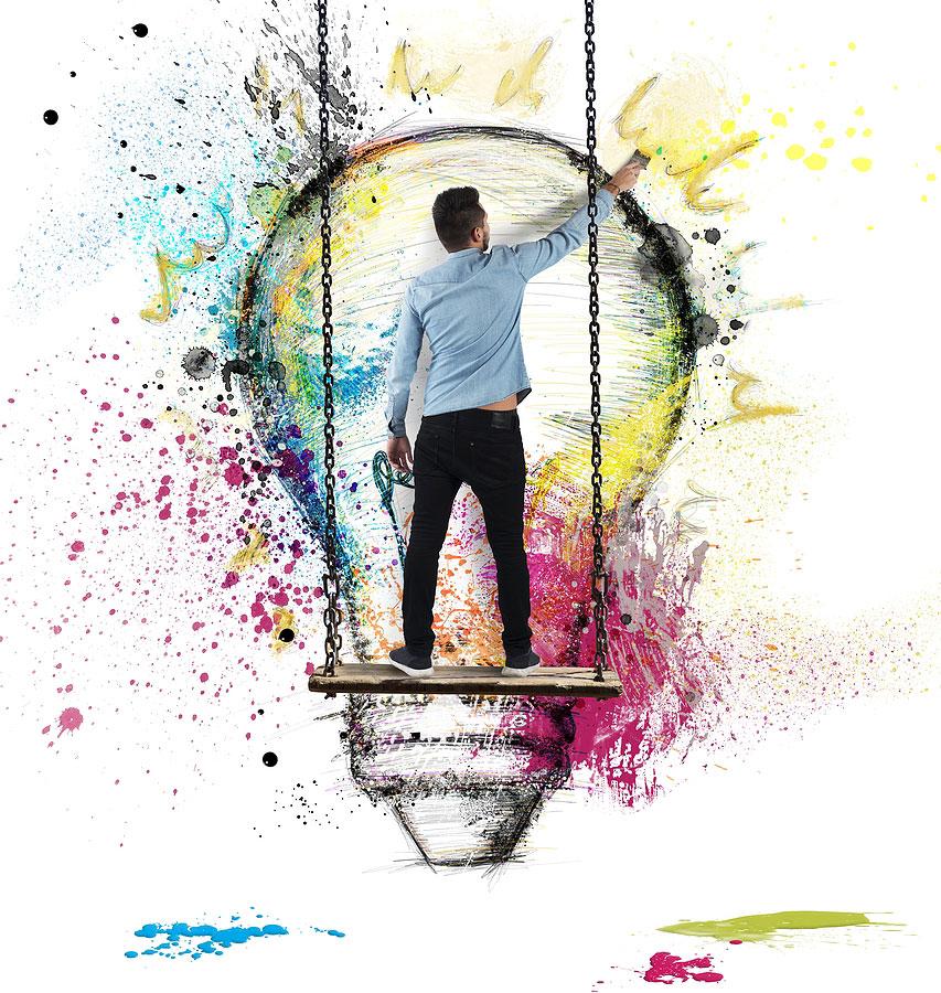 Graphic designer painting lightbulb